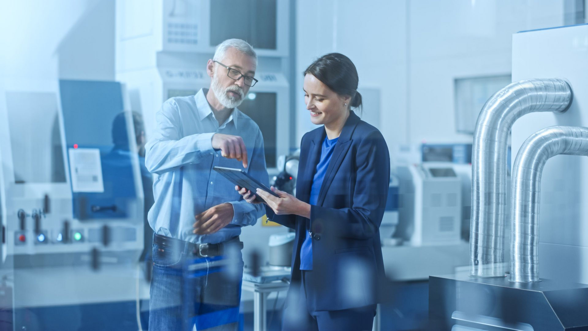 Two people looking at a tablet - parts inventory management - MATE PCS